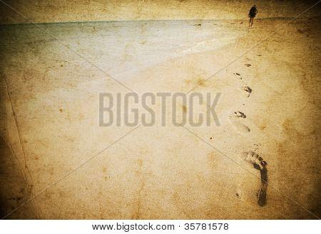 Vintage photo of footprints on beach