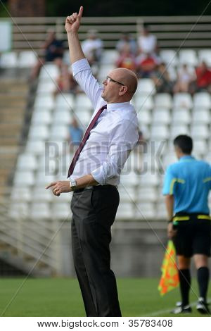 KAPOSVAR, HUNGARY - AUGUST 4: Elemer Kondas (Debrecen trainer) in action at a Hungarian National Championship soccer game Kaposvar (white) vs Debrecen (red) August 4, 2012 in Kaposvar, Hungary.
