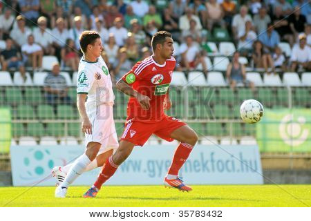KAPOSVAR, HUNGARY - AUGUST 4: Tamas Horvath (in white) in action at a Hungarian National Championship soccer game Kaposvar (white) vs Debrecen (red) August 4, 2012 in Kaposvar, Hungary.