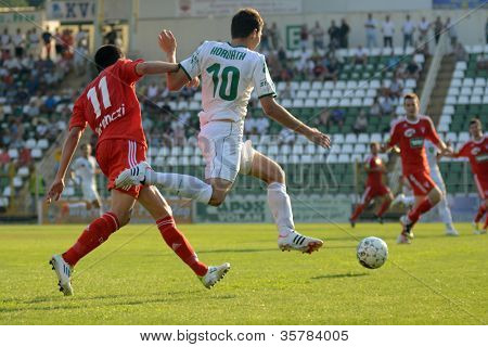 KAPOSVAR, HUNGARY - AUGUST 4: Tamas Horvath (white 10) in action at a Hungarian National Championship soccer game Kaposvar (white) vs Debrecen (red) August 4, 2012 in Kaposvar, Hungary.