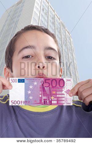boy with euro bills, business studio photo