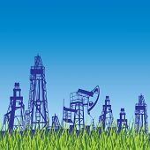 Oil rig and pump over blue background with grass.