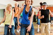or Jazzdance - young people dancing in a studio or gym doing sports or practicing a dance numb