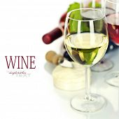 Grape and cheese with a bottles and glasses of red, rose and white wine  (easy removable sample text