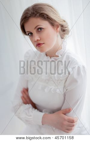 Beautiful woman in white retro dress