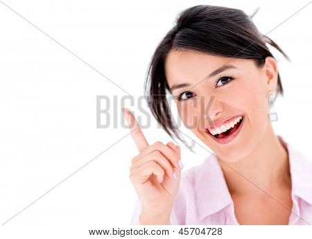 Happy woman pointing a great idea - isolated over a white background