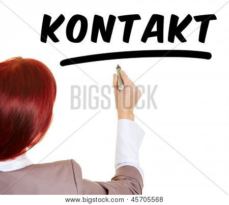 Business woman writing the German word Kontakt (meaning contact) with a pen