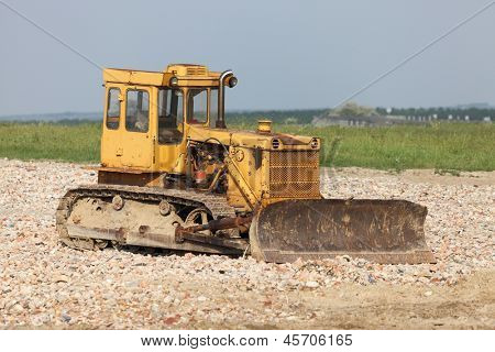 Old excavator machine at a construction site