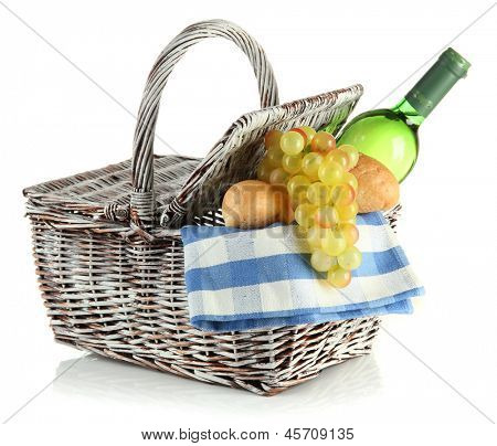 Picnic basket with grape and bottle of wine, isolated on white