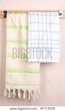 Bath towels on crossbar in room