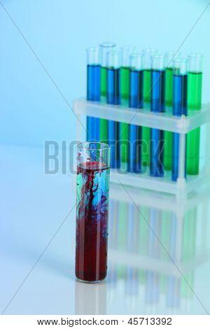 Test tubes on blue background