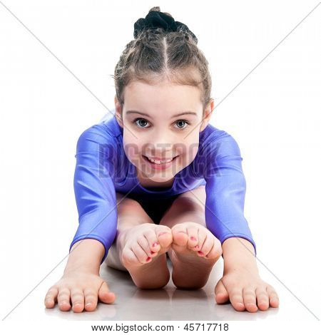 young girl doing gymnastics isolated over white background