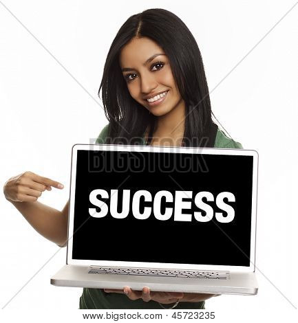 Smiling pretty young woman with friendly happy smile holding a laptop computer and pointing at screen where you add your marketing message