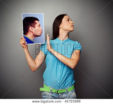 young woman refusing of kissing men