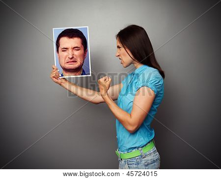 aggressive woman showing threatening fist to man