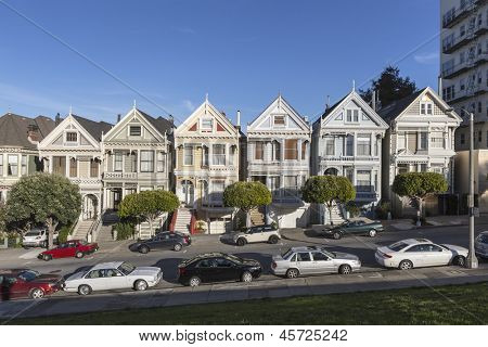 "SAN FRANCISCO, CA - JAN 15: World famous row of Victorian homes known as the ""Painted Ladies"" on January 15, 2013 in San Francisco, CA"