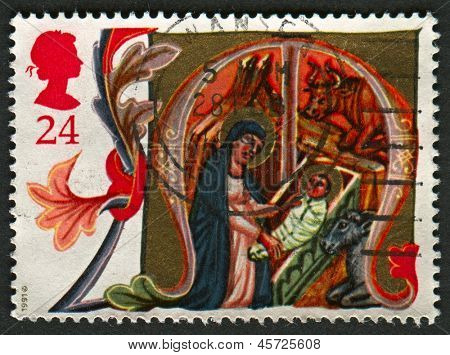UK - CIRCA 1991: A stamp printed in UK shows image of the Mary and Baby Jesus in Stable, circa 1991.