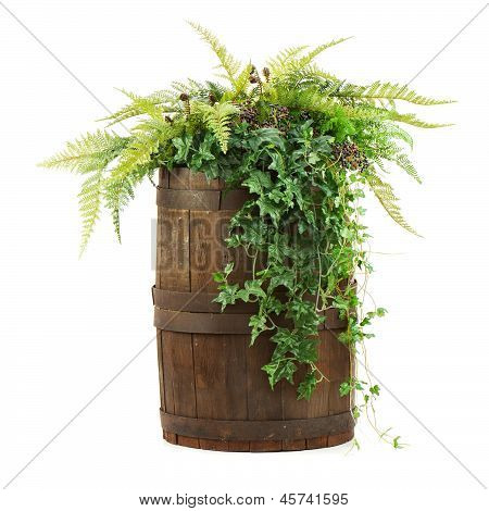 Composition Of Artificial Flowers In Old Wooden Barrel Isolated On White Background.