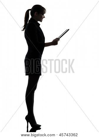 one business woman computer computing digital tablet  silhouette studio isolated on white background
