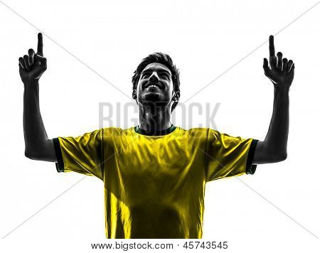 one brazilian soccer football player young man happiness joy pointing up  in silhouette studio isolated on white background