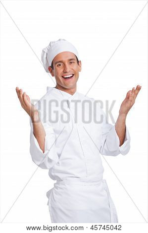 Male Chef Smiling And Making Hand  Gesturing