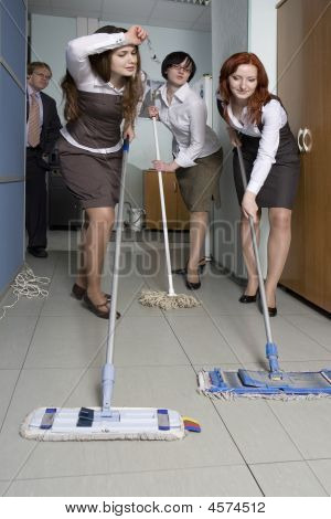 Attractive Clerks Washing The Floor In Office