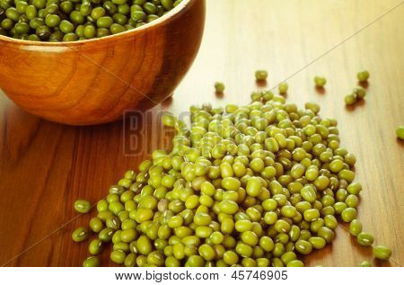 Green soybeans on wooden background, biologic agriculture