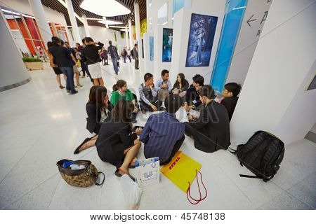 MOSCOW - AUG 20: Group of participants of Global Youth to Business forum sits on floor in lobby of congress-hall of Moscow School of Management SKOLKOVO, August 20, 2012, Moscow, Russia.