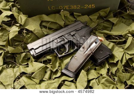 Handgun And Camo