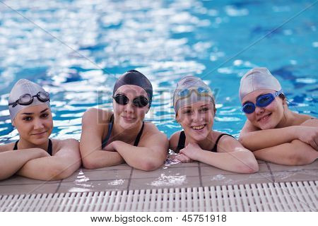 happy teen  group  at swimming pool class  learning to swim and have fun