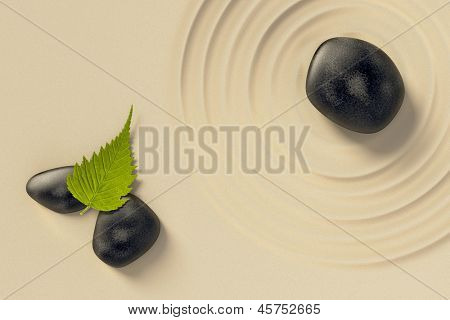 An image of a nice zen background with black stones and a leaf