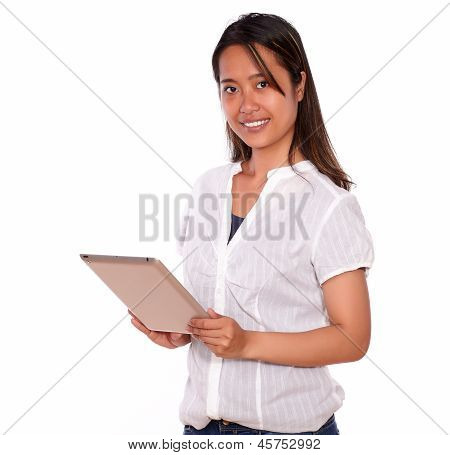 Smiling Asiatic Young Woman Using Her Tablet Pc