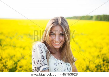 Sweet Woman Among Yellow Wildflowers In Summer