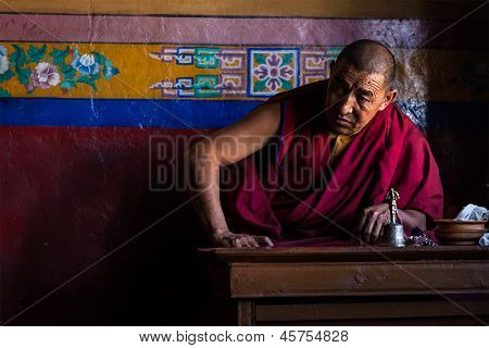 DISKIT, INDIA - SEPTEMBER 6: Tibetan Buddhist monk in gompa on September 6, 2011 in Diskit, India. Diskit gompa is oldest and largest Buddhist monastery (gompa) in the Nubra Valley of Ladakh, India