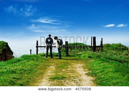 Two Hikers At The End Of Road