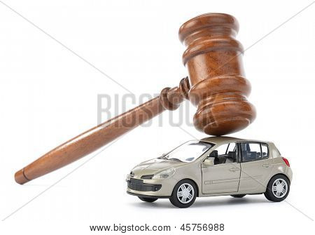 Gavel on car isolated on white background