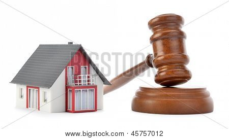 Gavel and house model for sub prime loan crisis concept