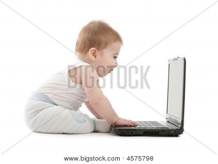 Surprised Baby Boy Express Working On Laptop