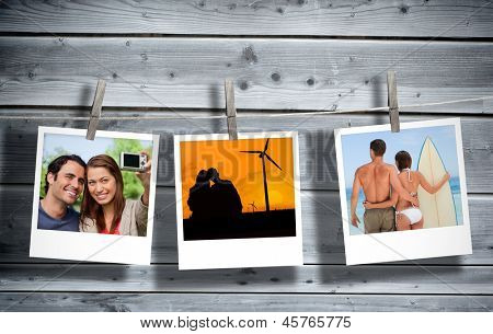 Serial instant photos of holiday scenes hung with a peg in line with wooden boards on the background