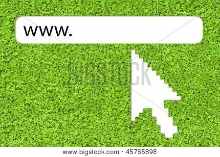 Big computer arrow pointing to url link over grass