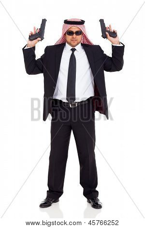 middle eastern hitman in black suit holding two handguns on white background
