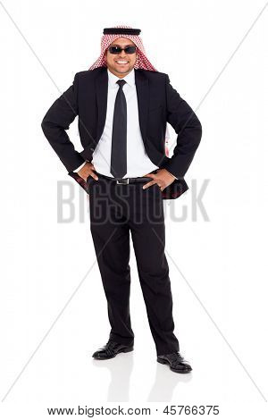 cheerful arab man in black suit posing on white background