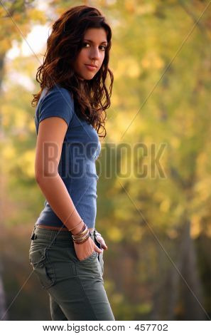 Brown-eyed Brunette With Hands In Pockets