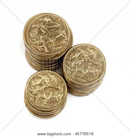Stacks of Australian one dollar coins, isolated on white background.