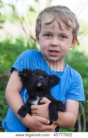 Portrait Of Boy With Puppy