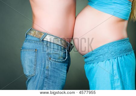 Humorous Photo Of Pregnant Woman And Man