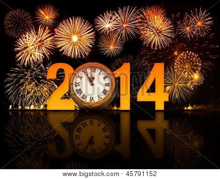 2014 year with fireworks and clock displaying 5 minutes before midnight