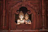 pic of shiva  - Shiva and Parvati wooden figures in the window of Shiva Parvati Hindu temple at Durbar Square in Kathmandu - JPG