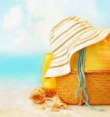 picture of suntanning  - Beach accessories on the sand near sea - JPG