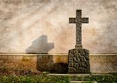 stock photo of tombstone  - Cross on a tombstone on the background of a dark wall - JPG